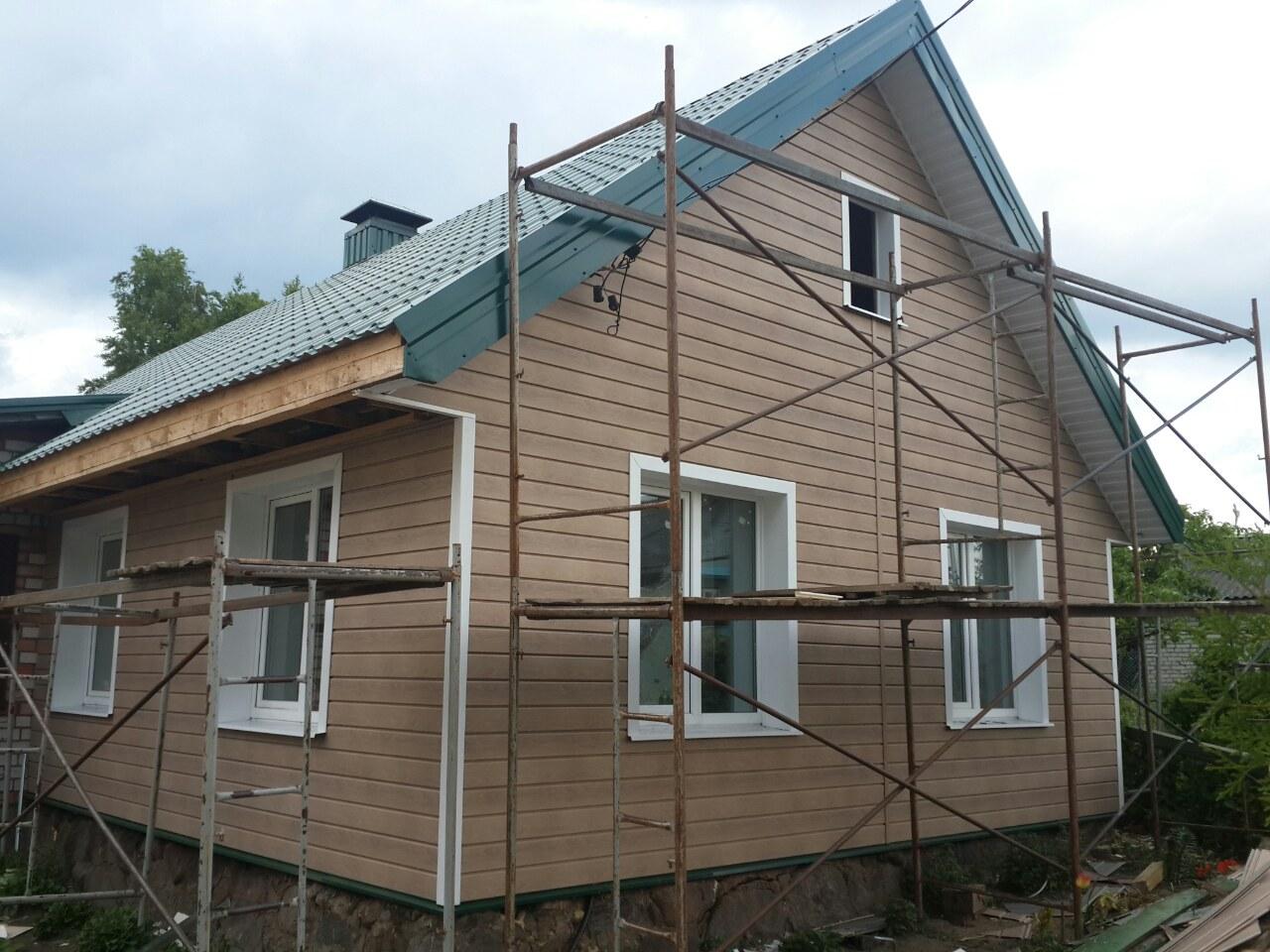 Фото отделки домов сайдингом карельский брус